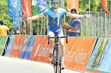 Kazakhstan's Yevgeny Nepomnyachshiy of VINO Astana Motors team finishes the race alone to complete the second stage of Tea Cup Cycle Tour yesterday in Kandy.  (Picture By Saman Mendis)