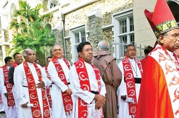 The Anglican clergy sporting red shawls with bold prints of the hammer and sickle