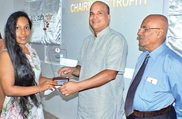 Media Executive Kishani Silva collects the Best Ever Implementation Division trophy from Chairman  Milinda Moragoda