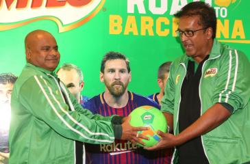 Vice President Nestle Lanka Norman Kannangara hands over a football to the Secretary to the Ministry of Education Sunil Hettiarachchi to mark the introduction of the under-12 schools football tournament named as the Road to Barcelona
