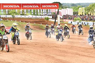 Boys and girls in the under-10 age group race on their 50cc bikes