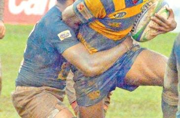 A Royal player attempts to break through an   Isipathana tackle