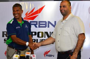 Agoal International director Dilroy Fernando shakes hands with Shakir Hafeez the managing director of RBN Performances to signal their deal