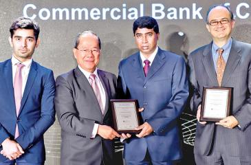 Commercial Bank's Regional Manager Sivasubramaniam Ganeshan (second from right) receives the awards on behalf of the Bank at the Asian Banker Transaction Awards at China World Hotel, China.