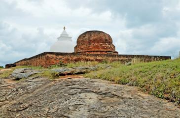JEWEL OF BANDAGIRIYA: The newly renovated dagoba and age-old reddish brick dagoba remaining at the top of Bandagiriya rock boulder