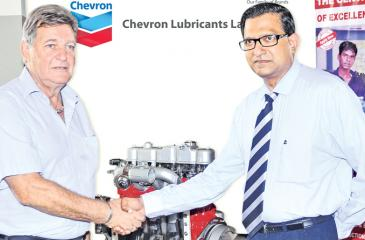 Handing over of the engine by Mr. Bertram Paul (General Manager Sales - Chevron Lubricants Lanka PLC) to Mr. Erwin Schulz – the Principal of SLGTI