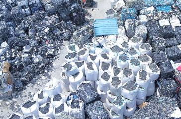 E-waste is piled high at a dump site in Samut Prakan province, south of Bangkok.