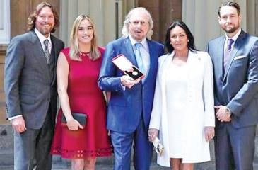 Proud moments: The star was surrounded by his family at the ceremony