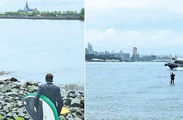 Holt was running late for his meeting and decided to hop on his paddle board to cross the river faster.
