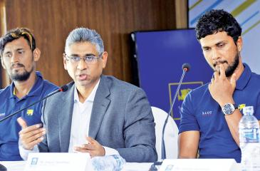 Dinesh Chandimal (right) reacts on his return from the West Indies along with Sports Minister Faizer Mushtapha and vice captain Suranga Lakmal Pic: Chinthaka Kumarasinghe