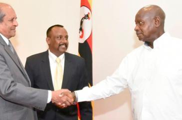 Minister of Foreign Affairs Tilak Marapana and Ugandan President Yoweri Kaguta Museveni greet each other