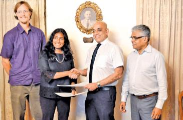 From left: Andrew Kittle  and Anjali Watson (Co-founders of WWTC), Romani de Silva (Deputy Chairman and MD of AFC), Mahinda Gunasekara (Director Sustainability, AFC) exchange the agreement.