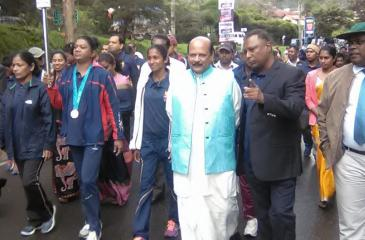 Susanthika Jayasinghe (third from left) marches with the Olympic Day Run torch