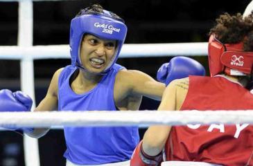 Anusha Kodithuwakku lands a straight-left on her opponent