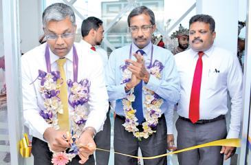 From left: Managing Director/CEO of HNBA and HNBGI, Deepthi Lokuarachchi, Chief Operating Officer of HNBA, Prasantha Fernando and Ratnapura Branch Manager Saman Kumara.