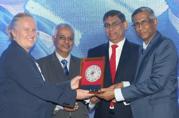 Jagath Perera, Prof. Lakshman R. Watawala and Jazri Magdon Ismail present a token of appreciation to IFAC President Rachel Grimes.