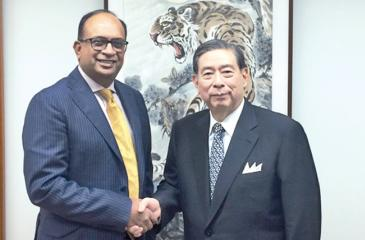 Sunshine Holdings Group Managing Director Vish Govindasamy with SBI Holdings President and CEO Yoshitaka Kitao after the  conclusion of the private placement in Tokyo on July 3.