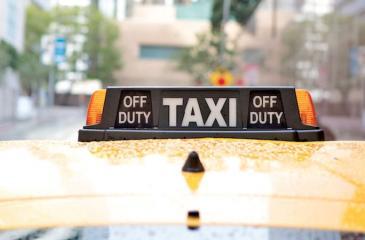 Taxi in the Rain in City