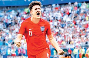 England's Harry Maguire  celebrates scoring his team's first goal in the quarter final against Sweden