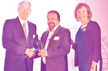 A DMS official receives the award from the Senior Vice President and Managing Director of Entrust Datacard in London.