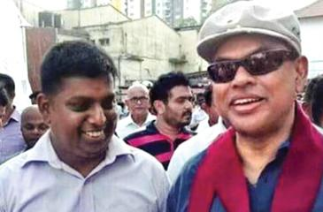Railway  trade union leader Indika Dodangoda, one of the main  protagonists of the recent lightning train strike, pictured here with  SLPP strongman and former Minister Basil Rajapaksa