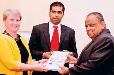 Dr. Chanaka Talpahera, Head of Office, UN-Habitat Sri Lanka, Ms. Libuse Soukapova, Head of Cooperation, Delegation of the European Union to Sri Lanka and the Maldives presenting the book to Velayuthan Sivagnansothy, Secretary, Ministry of Tourism Development