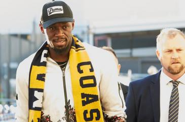 Usain Bolts arrives at the Sydney airport on Saturday to play for a football club (Photo courtesy AAP)