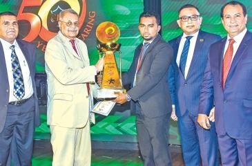 A top performer receives an award
