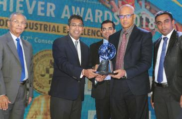 Teejay Lanka's Deputy General Manager – Internal Audit Hemantha Mannaperuma and Manager Operations – HR & Admin Tharindu Dissanayaka (second right and extreme right) receive the Silver Award in the Extra Large Category of the Manufacturing Sector from State Minister of National Policies and Economic Affairs, Dr. Harsha de Silva