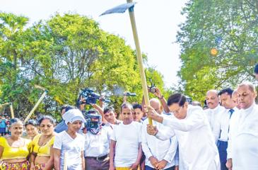 "President Maithripala Sirisena, eldest son of a farming family displays his skills with a mammoty by taking the first step to renovate the Kubukulawa tank in Polpithigama, which is the first of the 2,400 rural tanks connected with ""ellanga gammana"" or Cascaded Tank-Village system in the Dry Zone to be developed, together with the commencement of the Second Stage of Wayamba Ela, in North Western Province on Friday (Aug 24)."