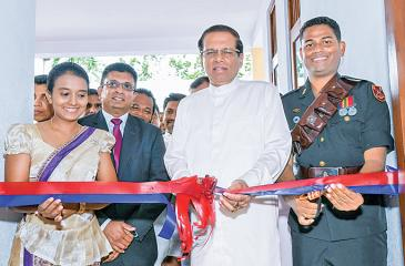 President Maithripala Sirisena at the presentation of the house to Sampath Sri Palansuriya.