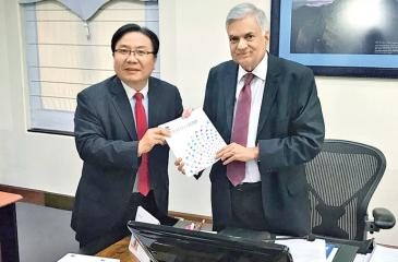 ADB Vice President Wencai Zhang presents a copy of ADB's new strategy, 'Strategy 2030' to Prime Minister Ranil Wickremesinghe.