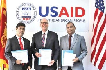 USAID Mission Director, Reed Aeschliman, with senior officials of Sampath Bank and Hatton National Bank following the launch of a partnership that provides local financing to MSMEs