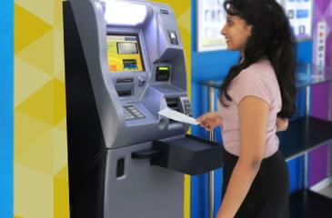 A depositor uses the fully-automated cheque deposit machine of Commercial Bank.