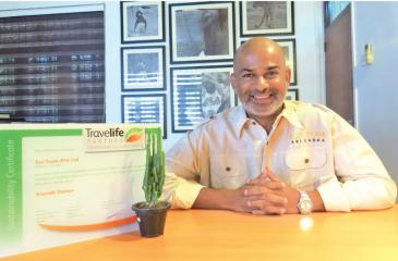 CEO/Founder Anuruddha Bandara with the Travel Life certification