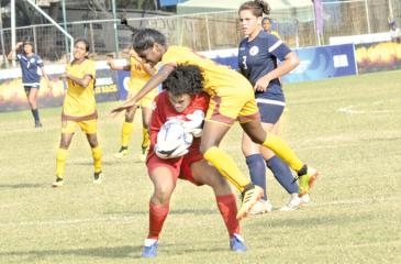 Sri Lanka's Senuri Bandara (in yellow) collides with Guam's goal-keeper Kiarra Annabella