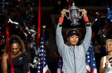 NEW YORK: Naomi Osaka of Japan poses with the championship trophy after winning the US Open AFP