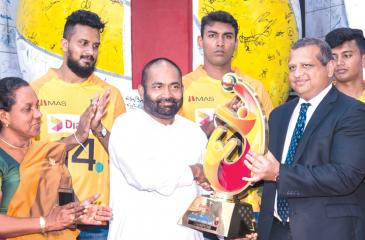 Navin Pieris - Head of Broadband and Fixed Telecommunications, Dialog Axiata officially hands over the Asian Volleyball Championship Trophy to president of the Sri Lanka Volleyball Federation Ranjith Siyamblapitiya MP and Minister of Power and Energy