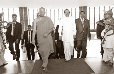 Prof Rev. W. Wimalaratana, Head, Department of Economics, University of Colombo accompanying President Maithripala Sirisena at the 3rd installment of the Tourism Leaders' Summit in 2017.