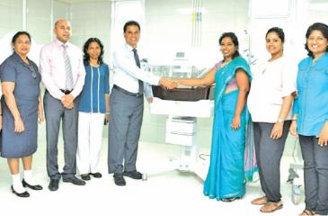 Handing over of the medical equipment purchased with funds from the 'Little Lives' fundraiser at the new building of the De Soysa Hospital for Women: From left Special Grade Nursing Officer W.D.P.L. Jeewandara, Special Grade Nursing Officer M.M.D. Dinesha Tharangani, Consultant Neonatologist Dr. Nalin Gamaathige, Consultant Neonatologist Dr. Nishani Lucas and Director Dr. Sudath Dharmarathna from DSHW and Dr. Ashwini de Abrew, Thushanthi Ponweera, Amila Jayamaha and Marianne David from the 'Little Lives' te