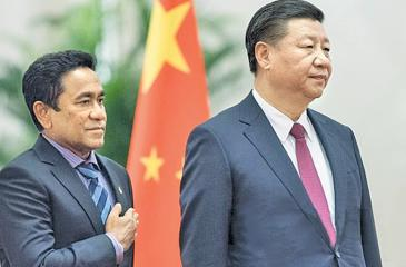 In this file photo taken on December 7, 2017 Maldives' President Abdulla Yameen (L) and China's President Xi Jinping listen to their national anthems during a welcome ceremony at the Great Hall of the People in Beijing. Back when he was a mild-mannered civil servant, few in the Maldives predicted Abdulla Yameen would one day run the country, let alone with an iron grip, locking up judges, his rivals and even his 80-year-old half-brother