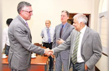 MCC COO Jonathan Nash and Chargé d'affaires ad interim Robert Hilton greets Prime Minister Ranil  Wickremesinghe