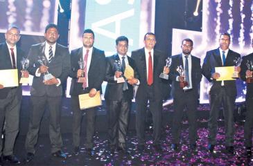 From left: SLIM NASCO 2018 Award recipients: Aloka Gayan Sansirige, Eranga Gayan Vithanage, Sisira Senarathna, P. S. Weerasooriya, Muditha Pathirana, Suranga Sanjeewa Kumara, Asanka Halangoda and Susantha Abeysinghe.