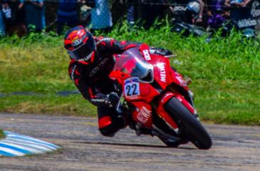 Aaron Gunawardena races on his bike