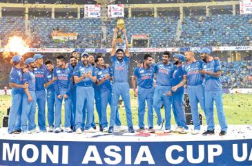 The Indian cricket team celebrates winning the Asia Cup by beating Bangladesh in the final (AFP)