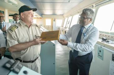 Captain Filipov Genchev with CEO of Hambantota International Port Services (HIPS), Ravi Jayawickrama exchange a welcome plaque commemorating this inaugural visit. K-Line local agent, Executive Director of ABC shipping (Pvt) Ltd. Roshan Dissanayake and his team were also present.