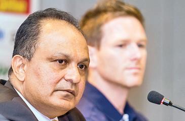 CEO Ashley de Silva takes up a question in the presence of England captain Eoin Morgan