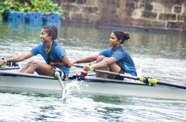 The 'A' Double Scull winning duo of Medhini de Alwis and Senuri de Silva from Musaeus College row to victory over Ladies College at their annual rowing meet on the Beira Lake yesterday