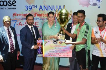 Captain of the Expolanka football team M Shazny receives the Cup from Colombo Mayor Rosy Senanayake after his team emerged champs at the 39th Mercantile Football Sevens tournament that also commemorated 100 years of the sport in Sri Lanka  Picture by Sudath Nishantha