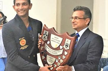 S. Thomas' College hockey captain Dewmal Palapathwala receives the Neville de Alwis Challenge Shield from Avindra de Silva,  Thomian hockey captain of 1975 after his team won their annual match against Trinity College 3-0 (Picture by Herbert Perera)